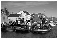 Tugboats and waterfront buildings. Portsmouth, New Hampshire, USA ( black and white)