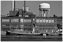 Tugboats and brick buildings, Naval Shipyard. Portsmouth, New Hampshire, USA ( black and white)