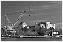 Crane and former prison called The Castle. Portsmouth, New Hampshire, USA (black and white)