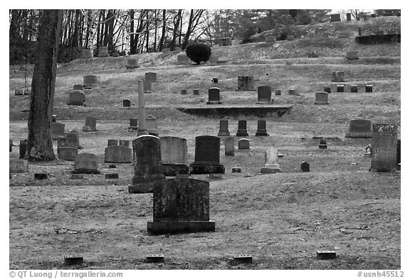 Headstones of different sizes in cemetery. Walpole, New Hampshire, USA (black and white)