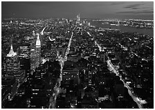 Streets at night from above with twin towers in background. NYC, New York, USA (black and white)