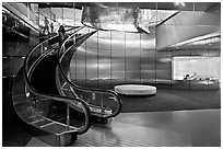 Curved moving staircase and meeeting room, Bloomberg building. NYC, New York, USA ( black and white)