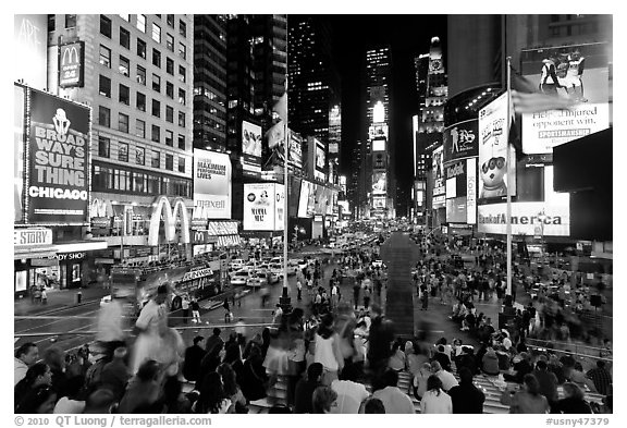 Crowds on Times Squares at night. NYC, New York, USA (black and white)