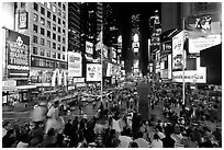 Crowds on Times Squares at night. NYC, New York, USA ( black and white)