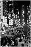 One Times Square at night and Francis Duffy monument. NYC, New York, USA ( black and white)