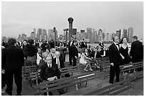 Black Tie gala guests on boat deck, New York harbor. NYC, New York, USA (black and white)