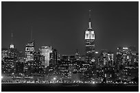Mid-town Manhattan skyline by night. NYC, New York, USA ( black and white)