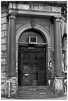 Door of old building on Bowery. NYC, New York, USA (black and white)
