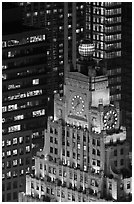 Top of vintage high-rise building with globe and clocks. NYC, New York, USA ( black and white)