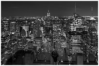 Woman on observation platform of Rockefeller center at night. NYC, New York, USA (black and white)