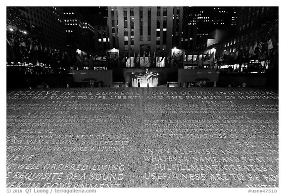 Rockefeller plaza and rink by night with Credo plaque. NYC, New York, USA (black and white)