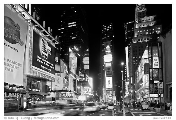 Taxis in motion, neon lights, Times Squares at night. NYC, New York, USA (black and white)