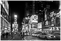 Yellow taxicabs, Times Squares at night. NYC, New York, USA (black and white)