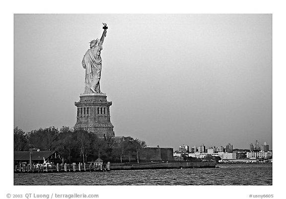 Statue of Liberty and Liberty Island from the back, sunset. NYC, New York, USA (black and white)