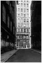 Narrow street. NYC, New York, USA (black and white)