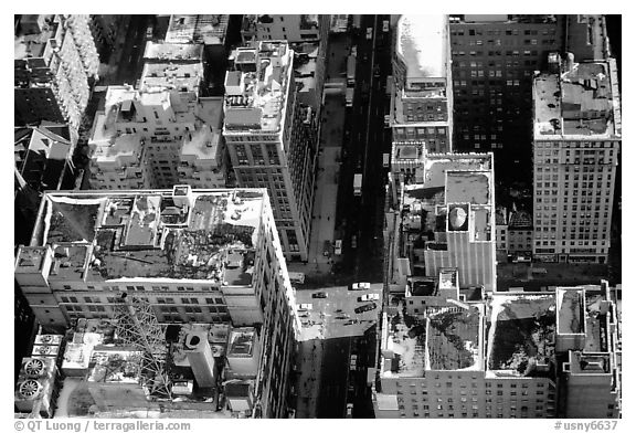 Canyon-like streets and yellow cabs seen from the Empire State building. NYC, New York, USA (black and white)