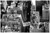 Canyon-like streets and yellow cabs seen from the Empire State building. NYC, New York, USA ( black and white)
