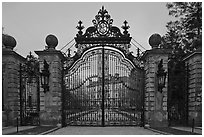 Entrance gate of the Breakers mansion at dusk. Newport, Rhode Island, USA (black and white)