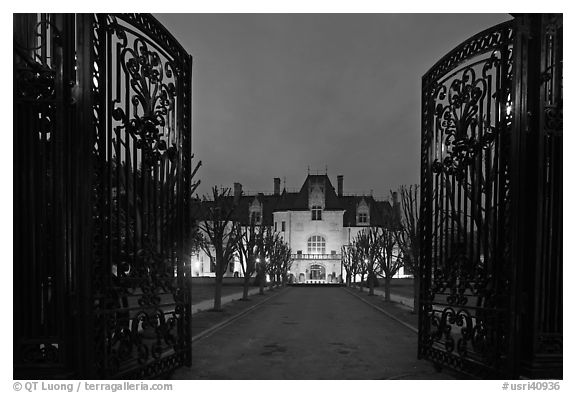 Entrance gate and historic mansion building at night. Newport, Rhode Island, USA (black and white)