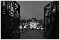 Entrance gate and historic mansion building at night. Newport, Rhode Island, USA ( black and white)