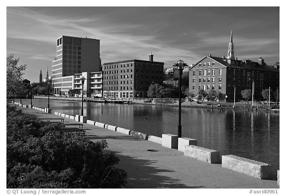 Brick buildings reflected in Seekonk river, late afternoon. Providence, Rhode Island, USA (black and white)