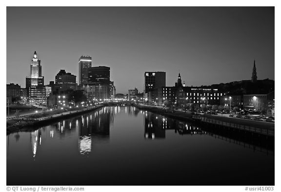 Wide view of downtown buildings reflected in Seekonk river at dusk. Providence, Rhode Island, USA (black and white)