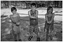 Children in summer dress holding large hailstones, Black Hills National Forest. Black Hills, South Dakota, USA (black and white)