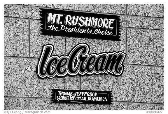 Sign about ice cream and presidents, Mount Rushmore National Memorial. South Dakota, USA (black and white)