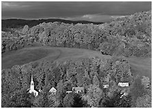 East Corinth village amongst trees in autumn color. Vermont, New England, USA (black and white)