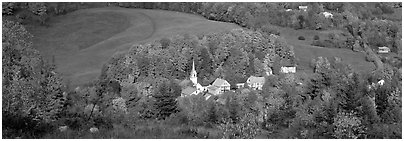 Vermont Village and hill in autumn, East Corithn. Vermont, New England, USA (Panoramic black and white)