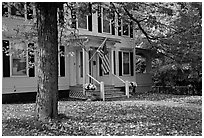 House with American flag and red leaves. Vermont, New England, USA ( black and white)