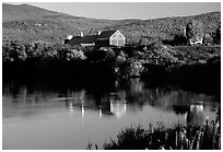 Red barns reflected in Line Pond near Pomfret. Vermont, New England, USA (black and white)