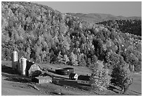 Farm surrounded by hills in fall foliage. Vermont, New England, USA ( black and white)