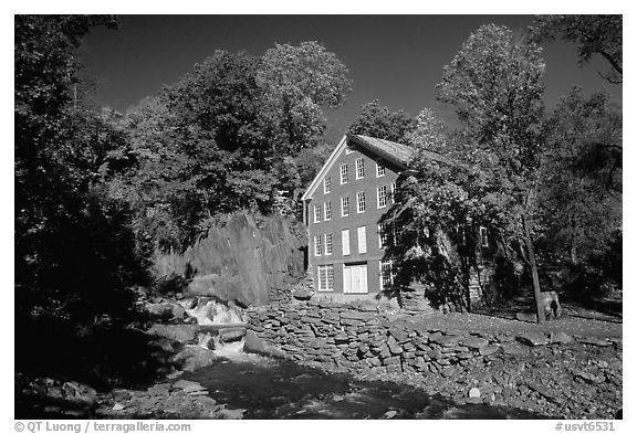 Old Mill next to a cascading brook near Stowe. Vermont, New England, USA (black and white)