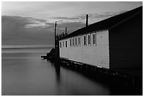Wharf building in Lake Superior at dusk, Apostle Islands National Lakeshore. Wisconsin, USA ( black and white)