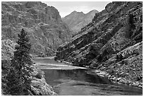 High cliffs above free-flowing part of Snake River. Hells Canyon National Recreation Area, Idaho and Oregon, USA ( black and white)