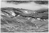 Painted hills with snow and fog. John Day Fossils Bed National Monument, Oregon, USA ( black and white)