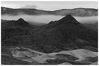 Buttes and fog at dusk. John Day Fossils Bed National Monument, Oregon, USA (black and white)