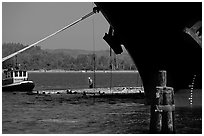 Timber, tugboat, and cargo boat bow. Oregon, USA (black and white)