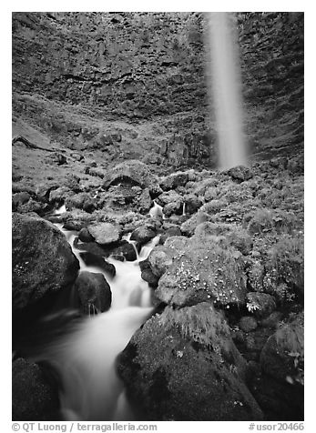 Mossy boulders and Watson Falls. Oregon, USA (black and white)