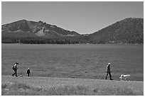 Family strolling on shore of East Lake. Newberry Volcanic National Monument, Oregon, USA ( black and white)