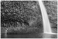Woman in bikini at the base of Horsetail Falls. Columbia River Gorge, Oregon, USA (black and white)