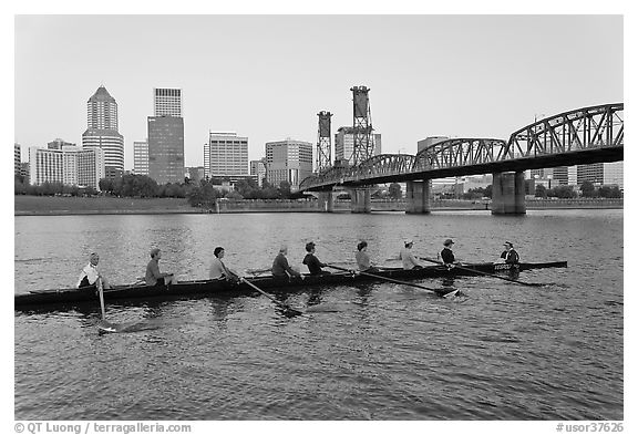Eight-oar shell on Williamette River and city skyline. Portland, Oregon, USA (black and white)