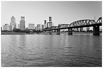 Portland skyline, Hawthorne Bridge, and Williamette River at sunrise. Portland, Oregon, USA (black and white)
