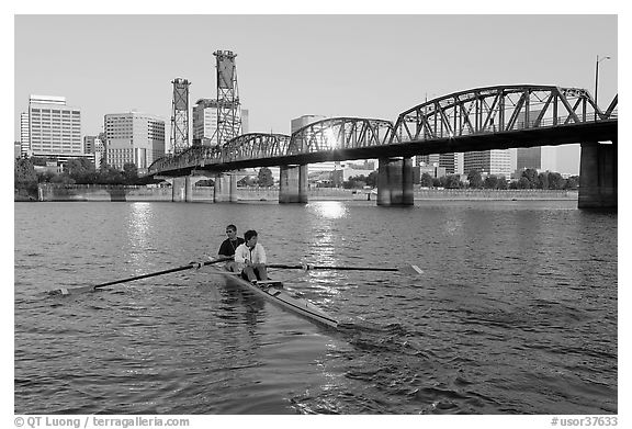 Men on double-oar shell rowing on Williamette River. Portland, Oregon, USA (black and white)