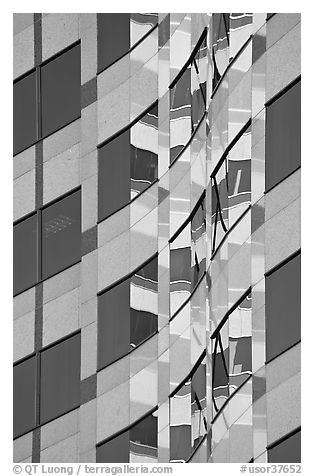 Pattern of windows and reflections in high rise building. Portland, Oregon, USA (black and white)