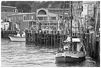 Fishing boats and pier. Newport, Oregon, USA ( black and white)