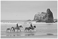 Women ridding horses on beach. Bandon, Oregon, USA (black and white)