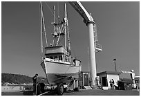 Fishing boat lifted onto deck, Port Orford. Oregon, USA (black and white)