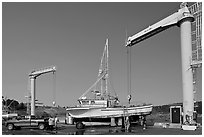 Hoists and fishing boats, Port Orford. Oregon, USA (black and white)